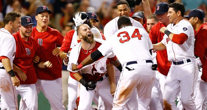 Mike Napoli (c) is mobbed by his Boston Red Sox team-mates