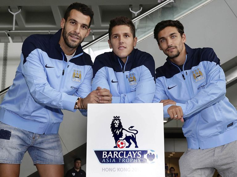 Alvaro Negredo, Stevan Jovetic and Jesus Navas pose for a photo.