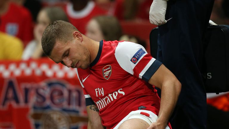 Lukas Podolski: Stretchered off against Fenerbahce