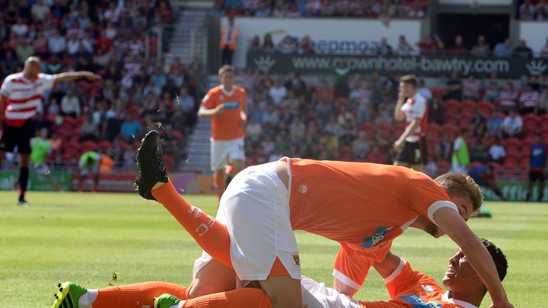 Blackpool: Steve Davies and Tom Ince celebrate at Doncaster