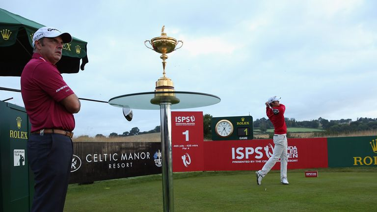 Espen Kofstad tees off with Paul McGinley watching