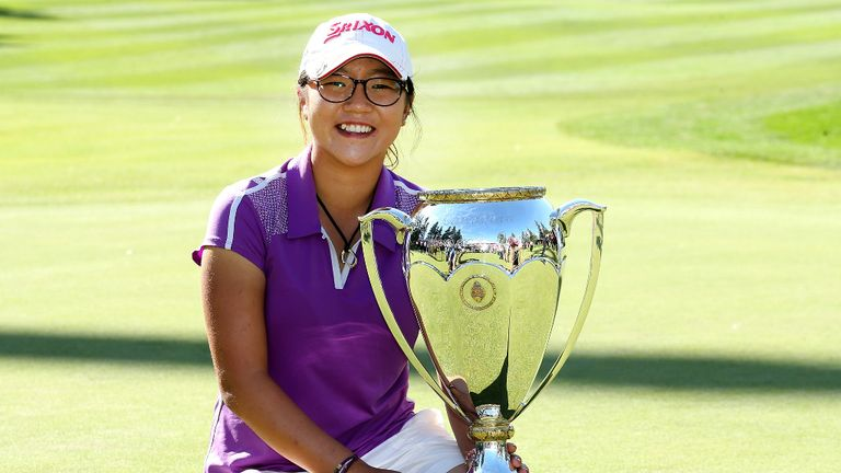 Lydia Ko poses with her second Canadian Open trophy in August