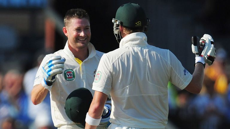 Michael Clarke (left) celebrates his century with Steve Smith
