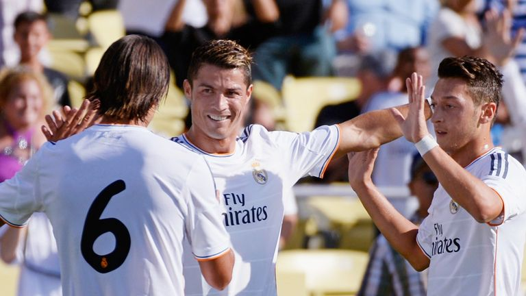 Cristiano Ronaldo celebrates his opener with Sami Khedira and Mesut Ozil