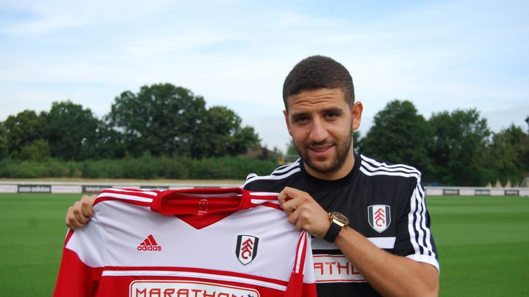 Adel Taarabt: Poses with his new shirt, (photo courtesy of Fulham FC)