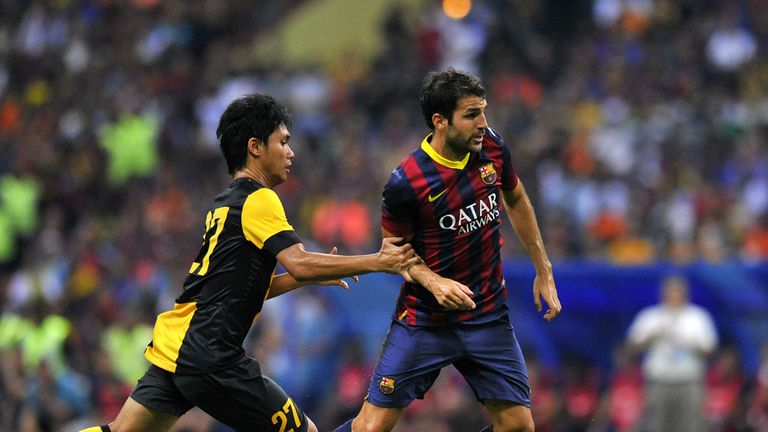 Cesc Fabregas: In action for Barcelona against Malaysia XI