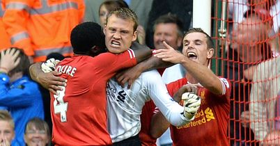 Simon Mignolet celebrates saving Jonathan Walters penalty
