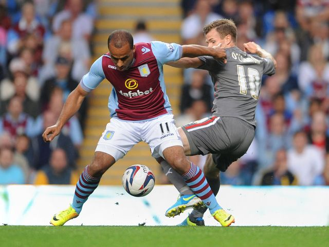 Gabriel Agbonlahor and Michael O'Connor battle for the ball