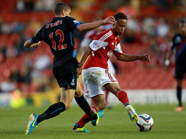 Bobby Reid and Stuart O'Keefe fight for possession