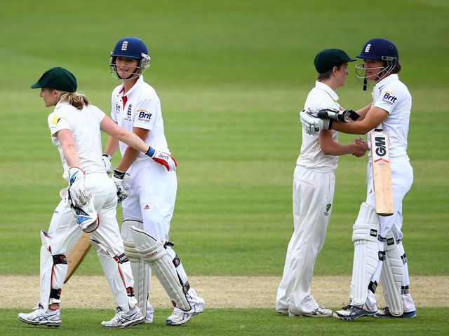 The players shake hands on a draw at Wormsley
