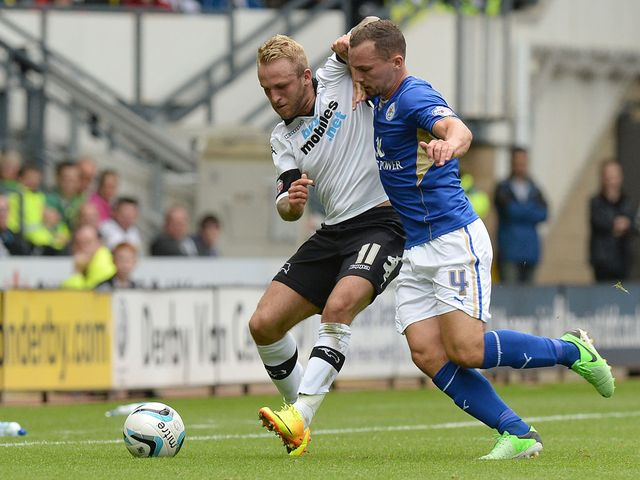 Johnny Russell and Danny Drinkwater battle for the ball