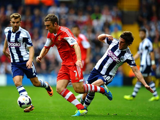 Rickie Lambert breaks away from Gareth McAuley