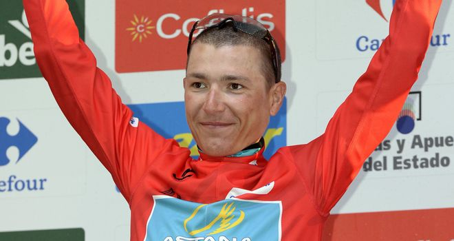 Janez Brajkovic led Astana over the line and now wears the leader's red jersey