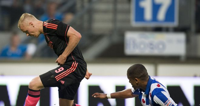 Ajax's Kolbeinn Sigthorsson is challenged by Heerenveen's Kenneth Otigba