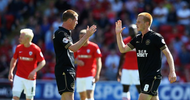 Ben Watson: Celebrates putting Wigan ahead at Barnsley
