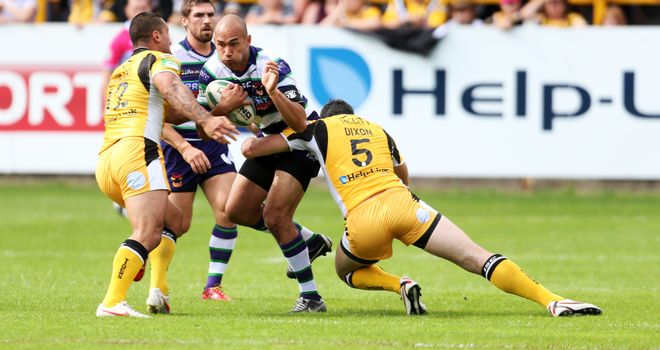 Castleford's Kirk Dixon and Weller Hauraki combine to stop Bradford's Keith Lulia