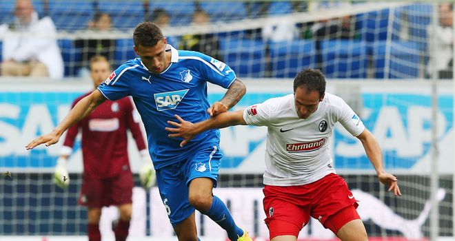 Fabian Johnson looks to get past Sebastian Freis