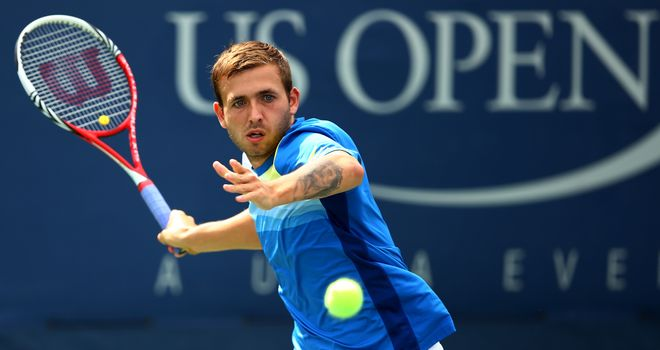 Daniel Evans of Great Britain returns a shot in the first round of the 2013 US Open