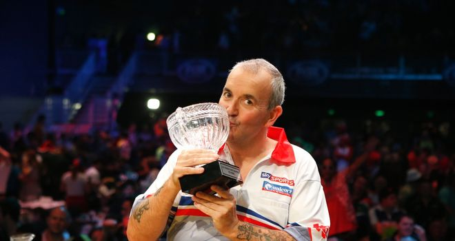 Phil Taylor with the Sydney trophy. Pic: Andrew Fawcett/PDC