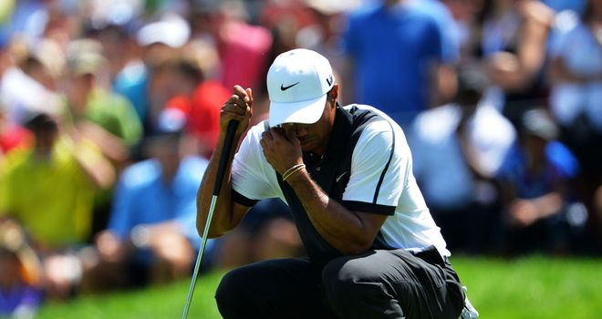 Tiger Woods: Struggled with a bad back in New Jersey