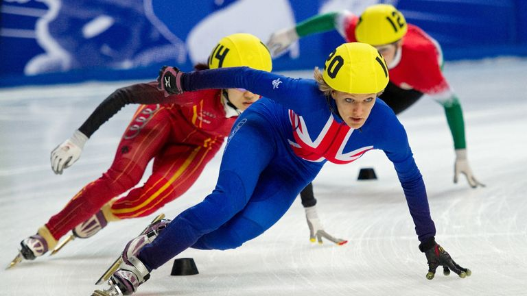 Elise Christie of Great Britain leading during the women's 1000m heats at the World Short Track Speed Skating Championships at the Sheffield Arena in Sheffield, northern England, on March 13, 2011.