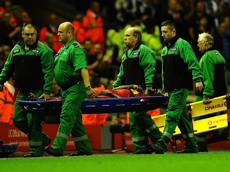 Kolo Toure leaves the field on a stretcher