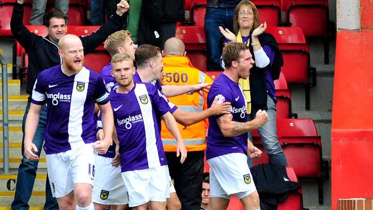 Johnny Mullins: Celebrates his goal for Oxford at Cheltenham