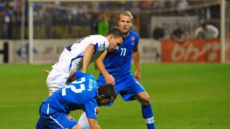 Bosnia's Edin Dzeko gets in a tangle