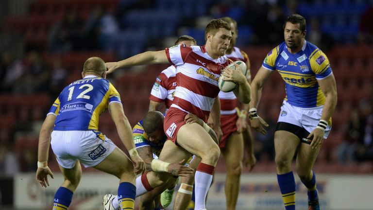 Wigan's Gil Dudson escapes the attentions of Carl Ablett and Ryan Bailey