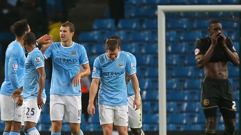 Edin Dzeko: Celebrates City's opener on Tuesday