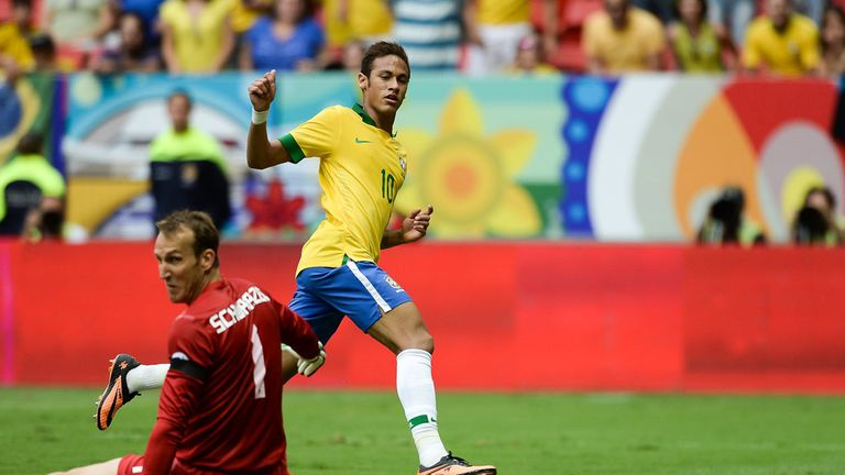 Neymar: Slides the ball past Australia keeper Mark Schwarzer