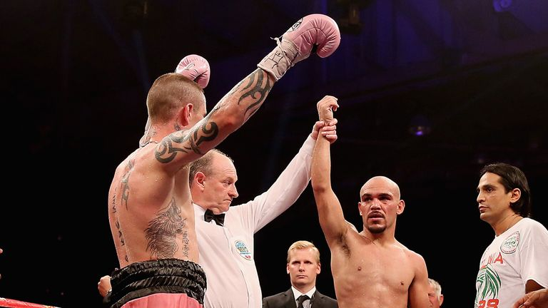 Burns raises his hands with Beltran expecting - like the crowd -the world title to slip away