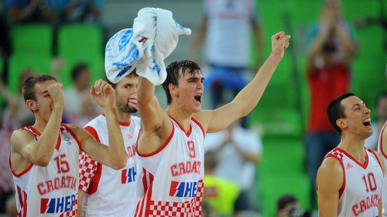 Dario Saric (C) and his Croatia team-mates celebrate victory over Ukraine