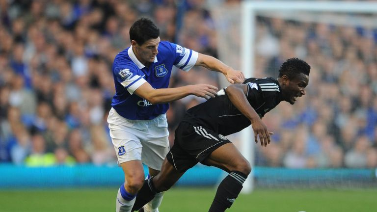 John Obi Mikel of Chelsea tangles with Gareth Barry of Everton