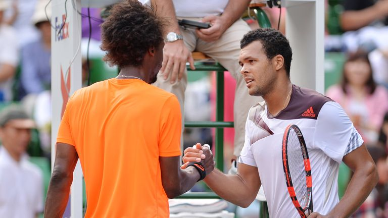 Jo-Wilfried Tsonga (r) shakes hands with Gael Monfils