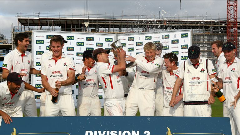 Lancashire celebrate winning the Division Two title with a game to spare