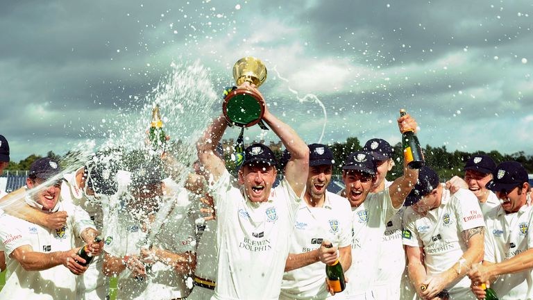 Durham celebrate winning Division One for a third time in six seasons