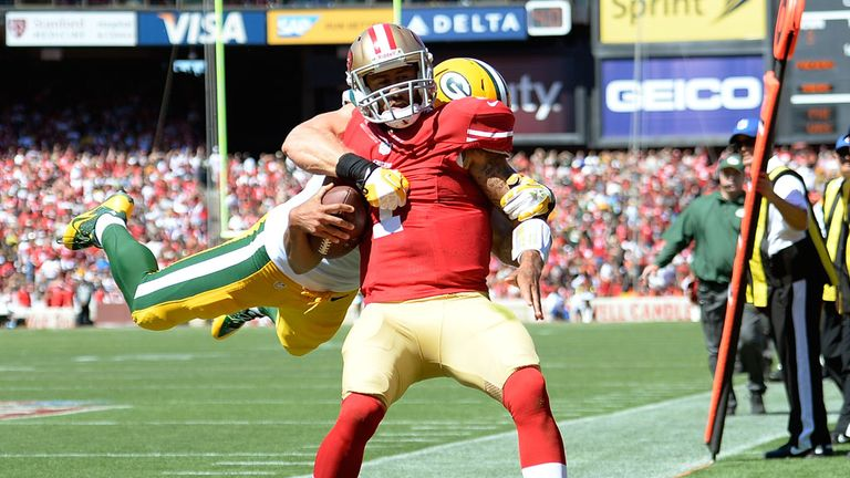 Clay Matthews of the Green Bay Packers tackles Colin Kaepernick of the San Francisco 49ers