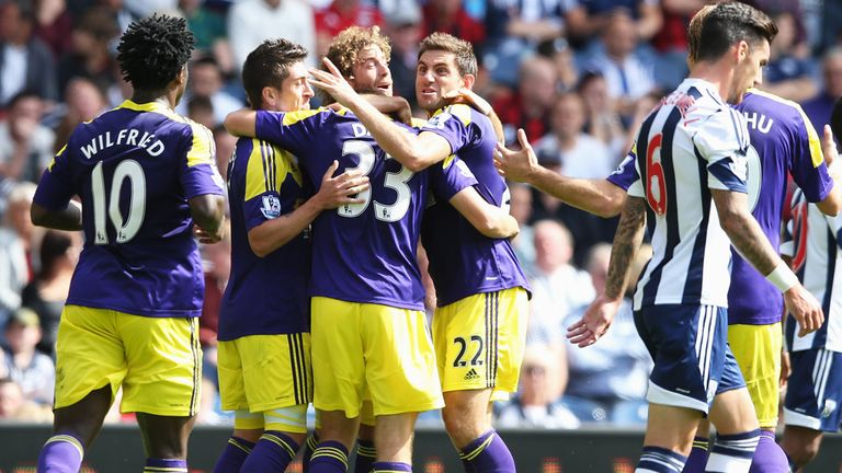 Ben Davies: Celebrates his opener for the visitors