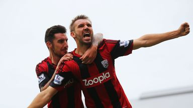 Gareth McAuley celebrates his late equaliser at Fulham
