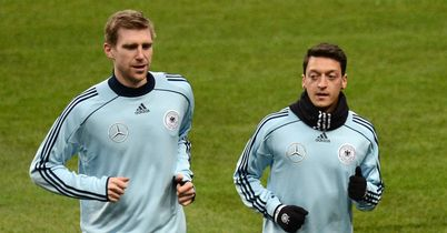Per Mertesacker: Delighted to see Mesut Ozil join him at Emirates Stadium