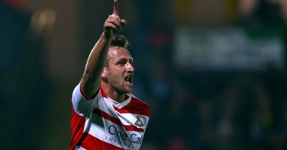 Chris Brown: Celebrates one of Doncaster's goals this season