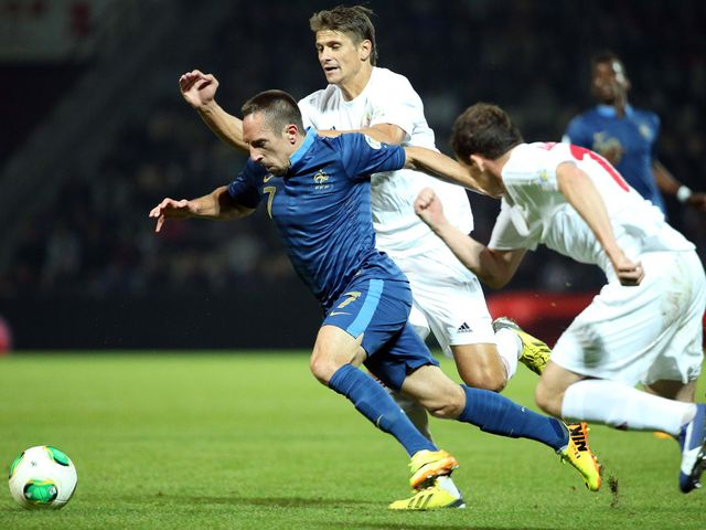 Franck Ribery tries to get forward for France