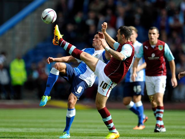 Jason Lowe and Danny Ings battle for the ball