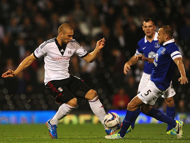 Pajtim Kasami and Johnny Heitinga tangle.