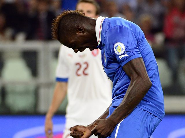 Mario Balotelli celebrates his goal for Italy
