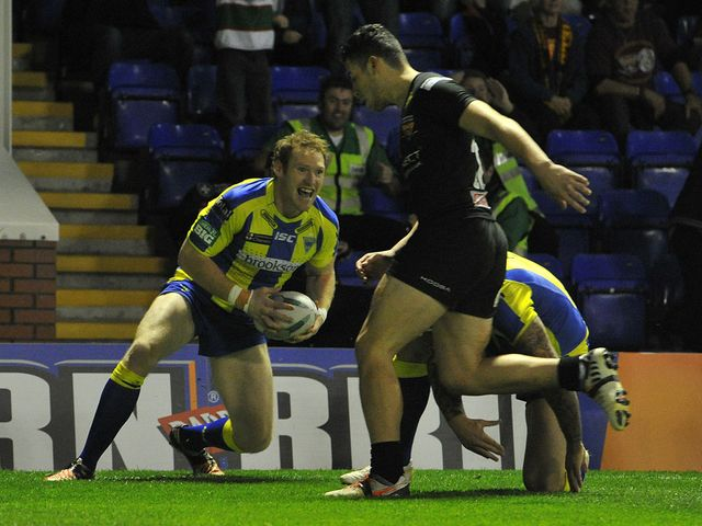 Joel Monaghan goes in for a Warrington try