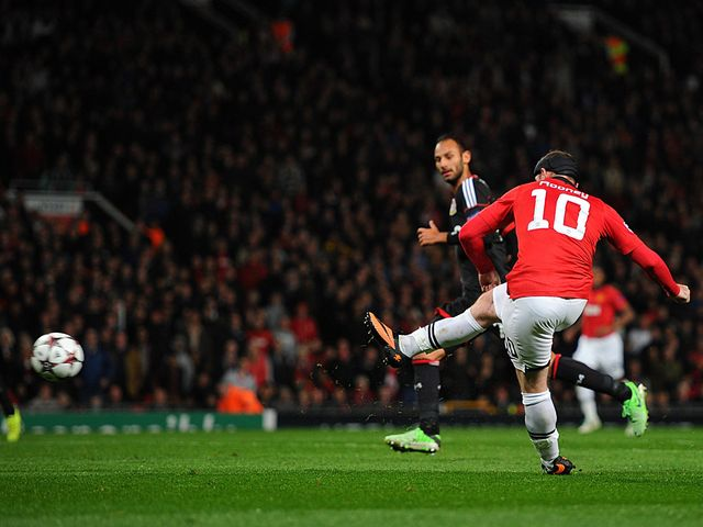 Wayne Rooney scores his second goal of the night