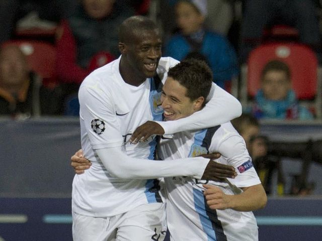 Yaya Toure celebrates with Samir Nasri during their victory