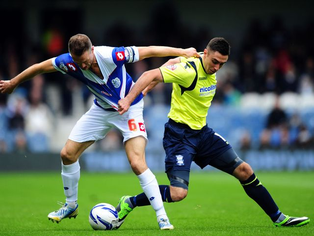 Clint Hill and Lee Novak compete for the ball